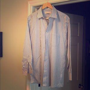 Long sleeve button up shirt.